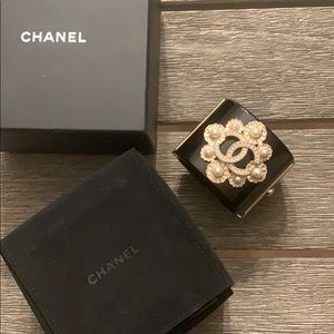 Chanel cuff resin and pearl and gold.